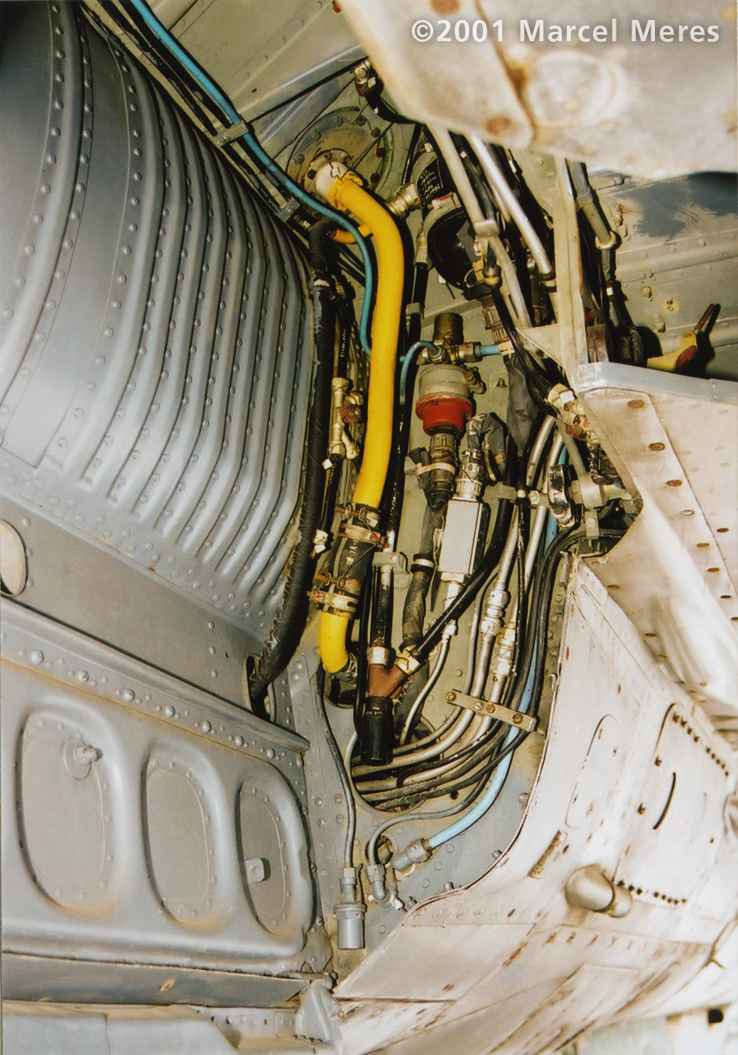 [MiG-21_M_Main_undercarriage_well_left_looking_back]